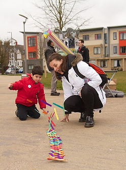 child and scientist making and releasing a stickbomb at Oxford Science Festival