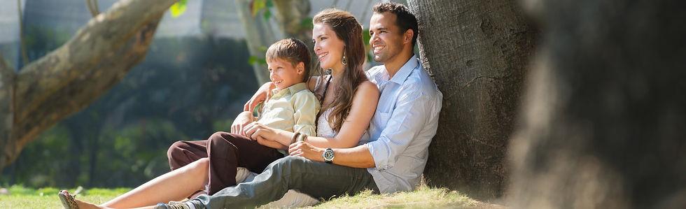 Happy Family Under a Tree