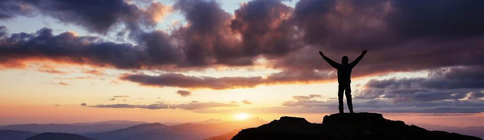 silhouette-of-man-praying-over-beautiful