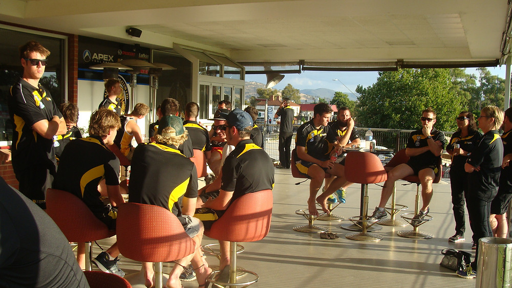 Players enjoying the balcony of the Albury Tigers Club Rooms