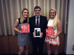Women's Team of the Year members Hannah Dunn (left) and Ella Ross (right) with Robert Anderson, Women's Coach of the Year