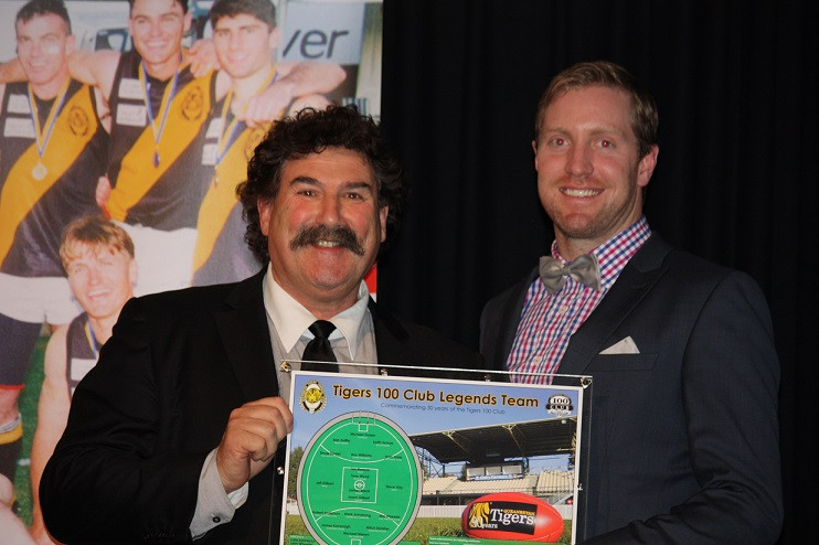 """Tigers Captain Ryan Quade being presented with a plaque of the LEGENDS Team by Robert """"Dipper"""" DiPierdomenico"""
