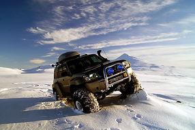 IceAk Super Jeep posing in the snow