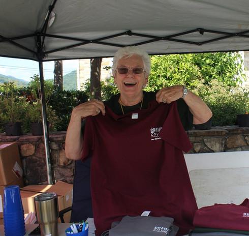 Kathy selling shirts.jpg