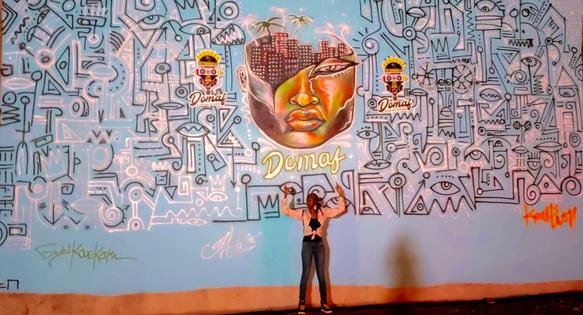 Murale réalisée au Douala Music'Art Festival en collaboration par Keulion, Guy Kouekam et MALICIOUZ