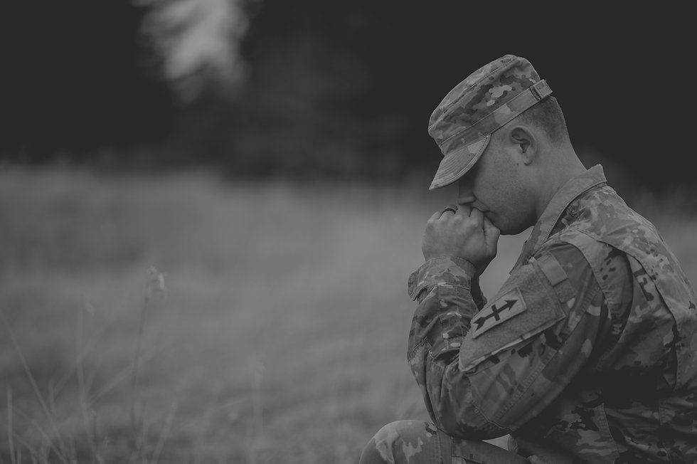 shallow-focus-shot-of-young-soldier-pray