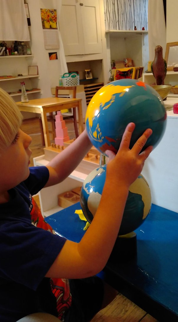 A child studying the globe
