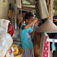a child playing outside his house