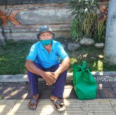 Mr Dewa, 74 yo, a parking guy at Tabanan Market
