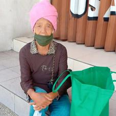 Mrs. Nyoman on the street of Tabanan