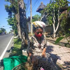 Ibu Kadek, 70 yo, vegetables street vendor in Tabanan