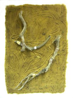 Holzaeste auf Sand