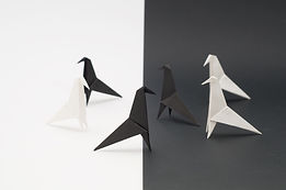 origami-paper-birds-flocking-on-black-an