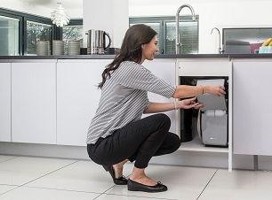 Woman loading Kinecto Premier Compact