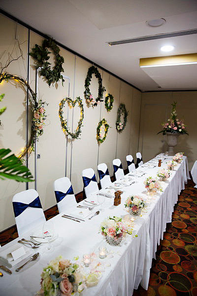 bridal table, wreaths and urns