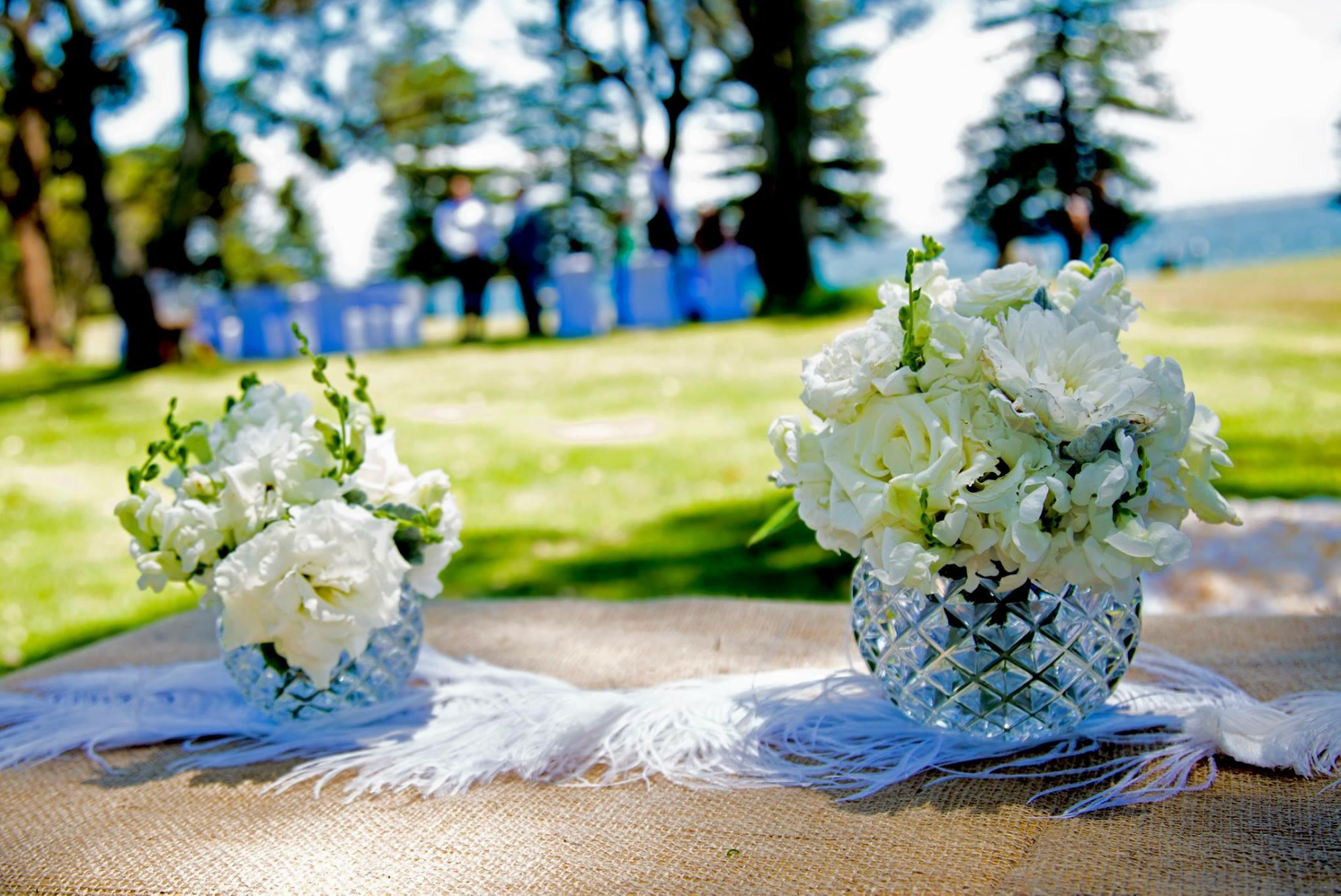 white posies in crystal vases