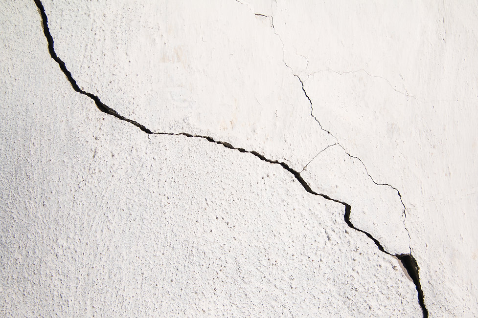 Crack. Texture of old painted white plas