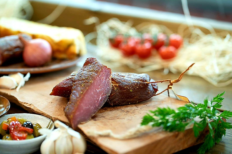 Pork steak cold smoked with herbs