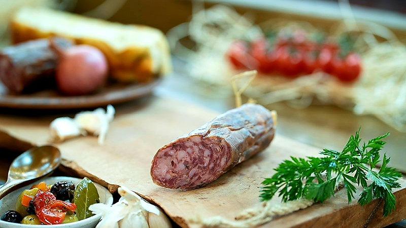 Pork, pine and juniper seeds salami