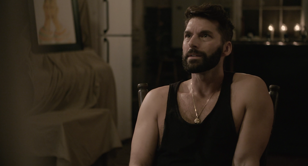 Rudy (Charlie David) wearing the Zeus medallion in Shadowlands Pygmalion Revisited