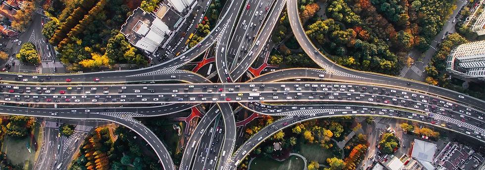 City-top-view-roads-traffic-cars-buildings_1920x1080_edited.jpg