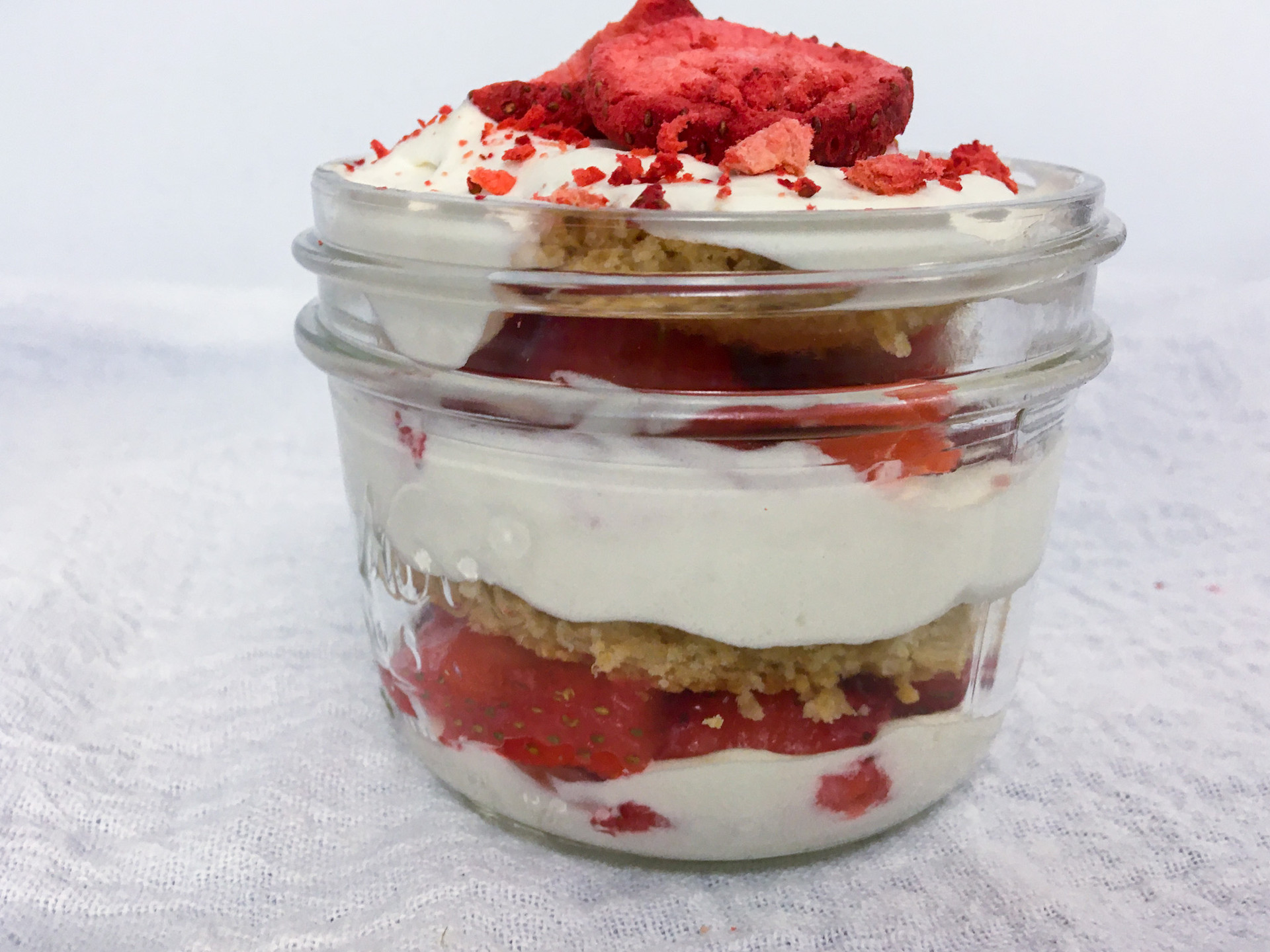 Strawberry, strawberries, strawberry shortcake, trifle, mason jar, Fourth of July, Independence Day, dessert, whipped cream, homemade whipped cream, freeze-dried strawberries, homeground wheat
