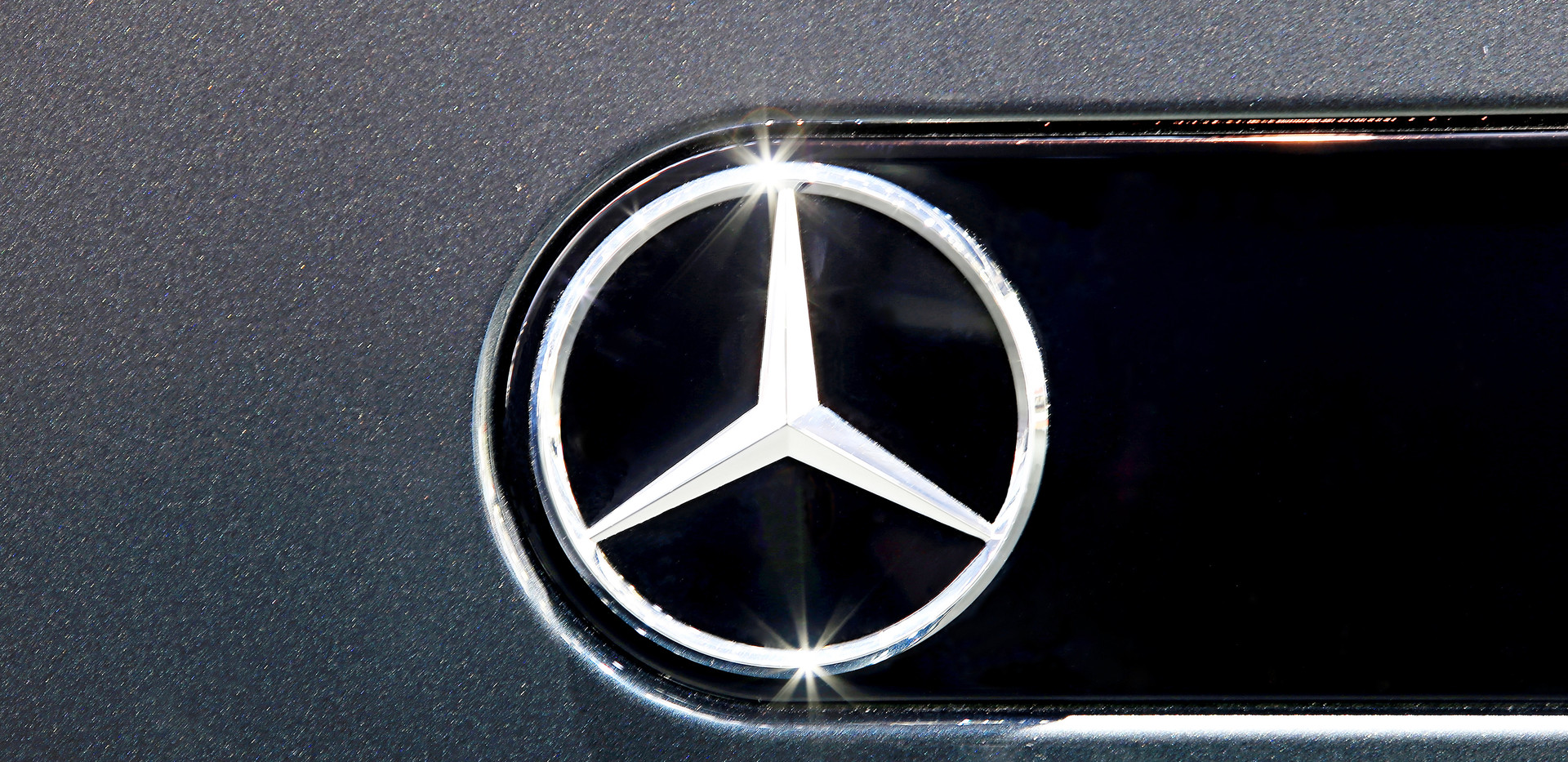 Close Up Logo Of Mercedes Benz On Black