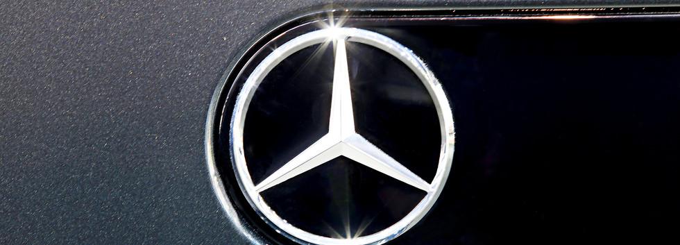 Close Up Logo Of Mercedes Benz On Black