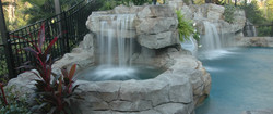 1-custom-pool-with-slide-and-rock-formation