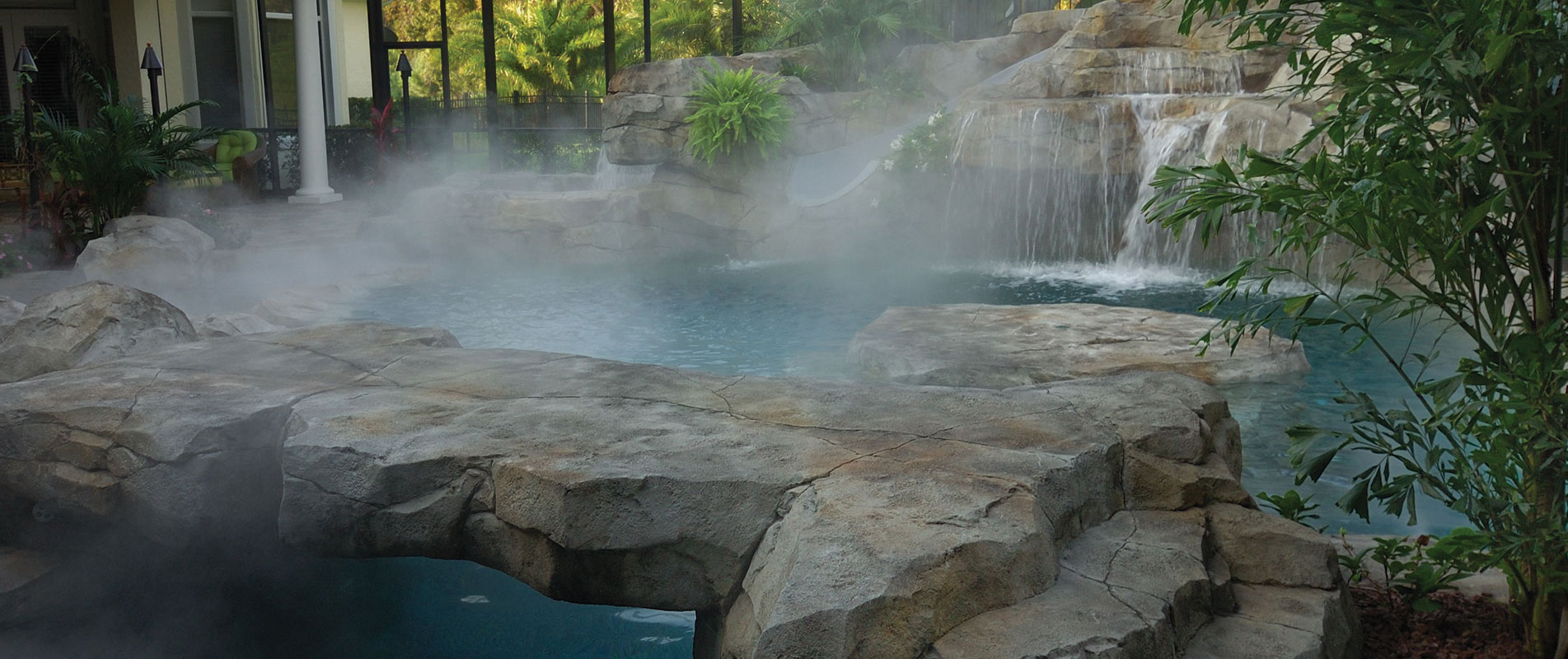 custom-pool-with-misting-system-and-rock-bridge