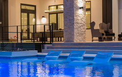custom-pool-with-swim-up-bar-and-fire-features-9