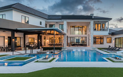 custom-pool-with-swim-up-bar-and-fire-features-4