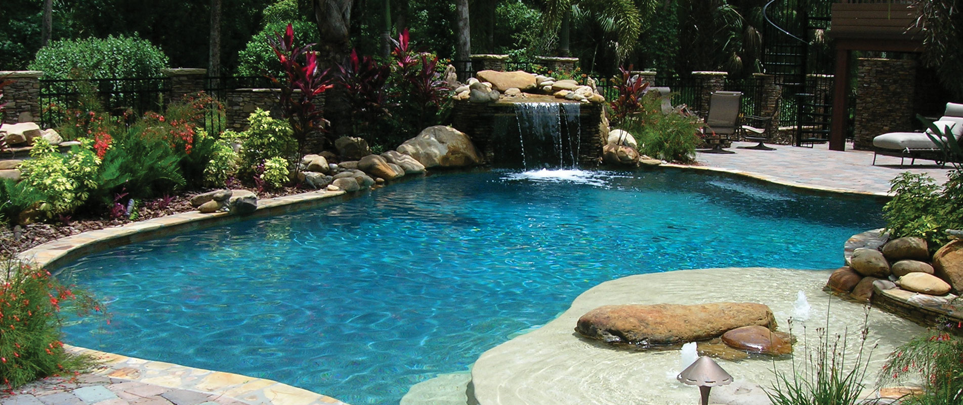1-lagoon-style-pool-with-rock-waterfall