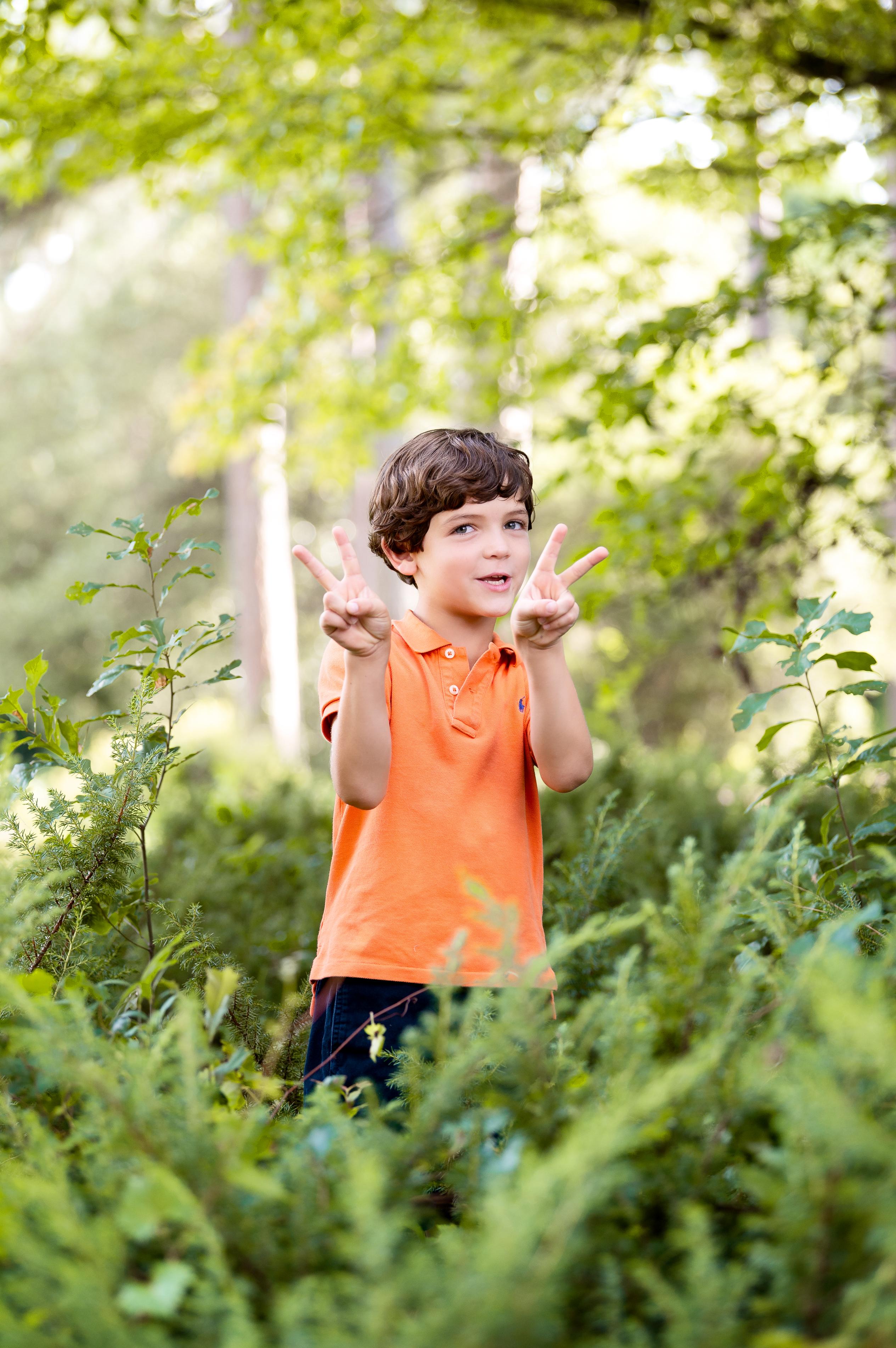 portrait of boy in bushes