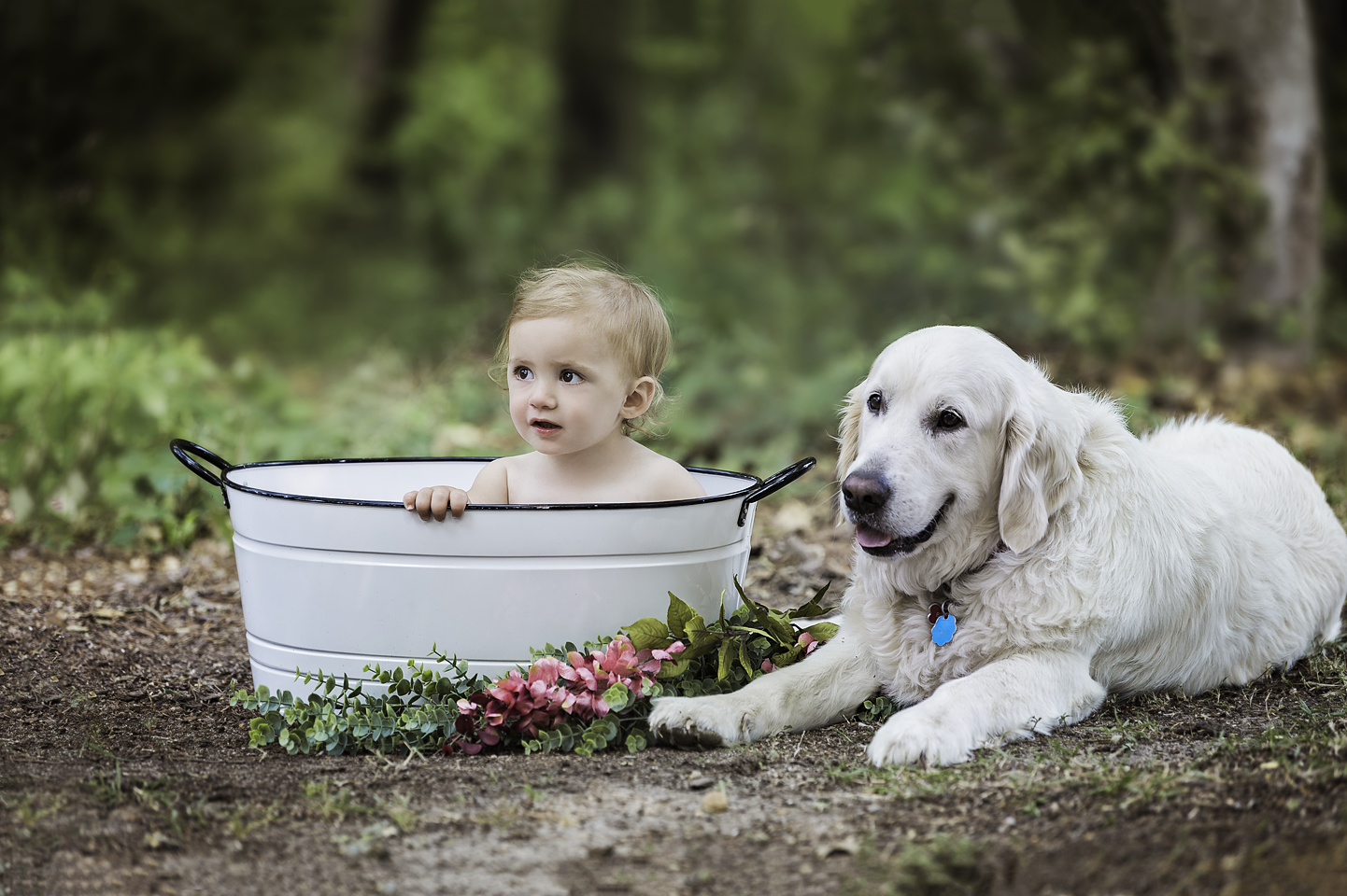 girl in tub with her dog