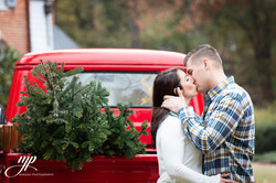 engagement picture couple red truck