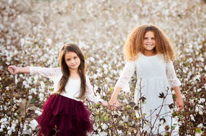 Two girls in cotton field pictures Southern Pines Aberdeen Cameron Pinehurst
