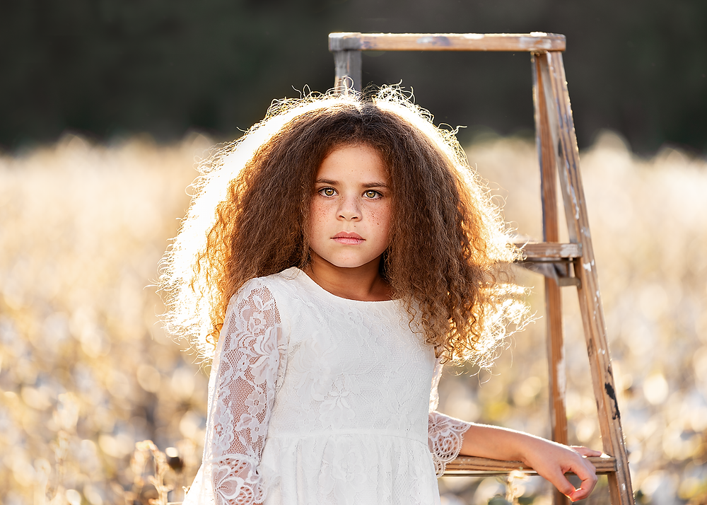 portrait girl wearing dress in cotton field southern Pines photographer makana family pictures