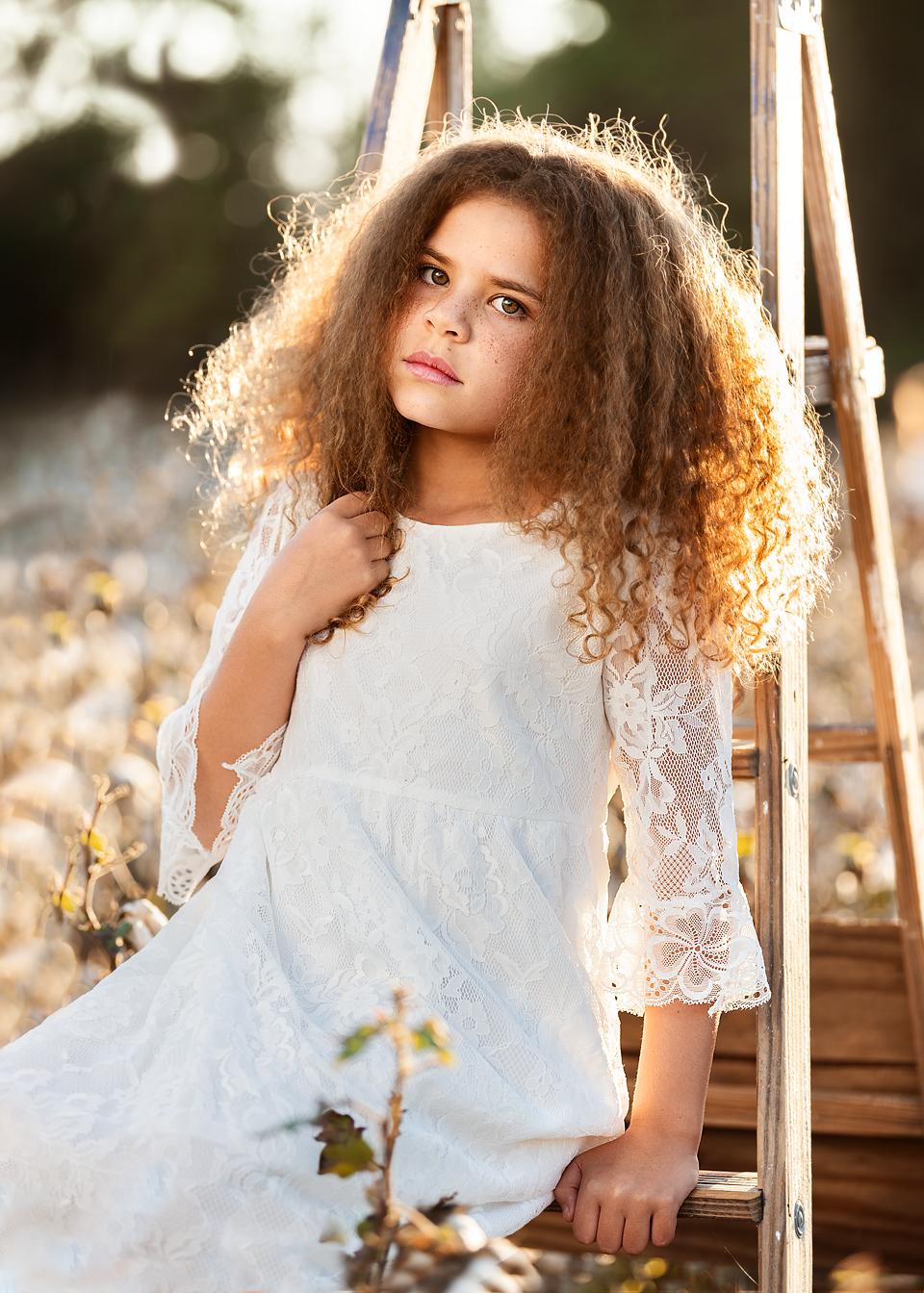 family photographer southern Pines Pinehurst girl in cotton field portrait