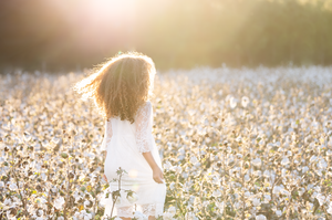 family photographer southern Pines Pinehurst girl in cotton field portrait