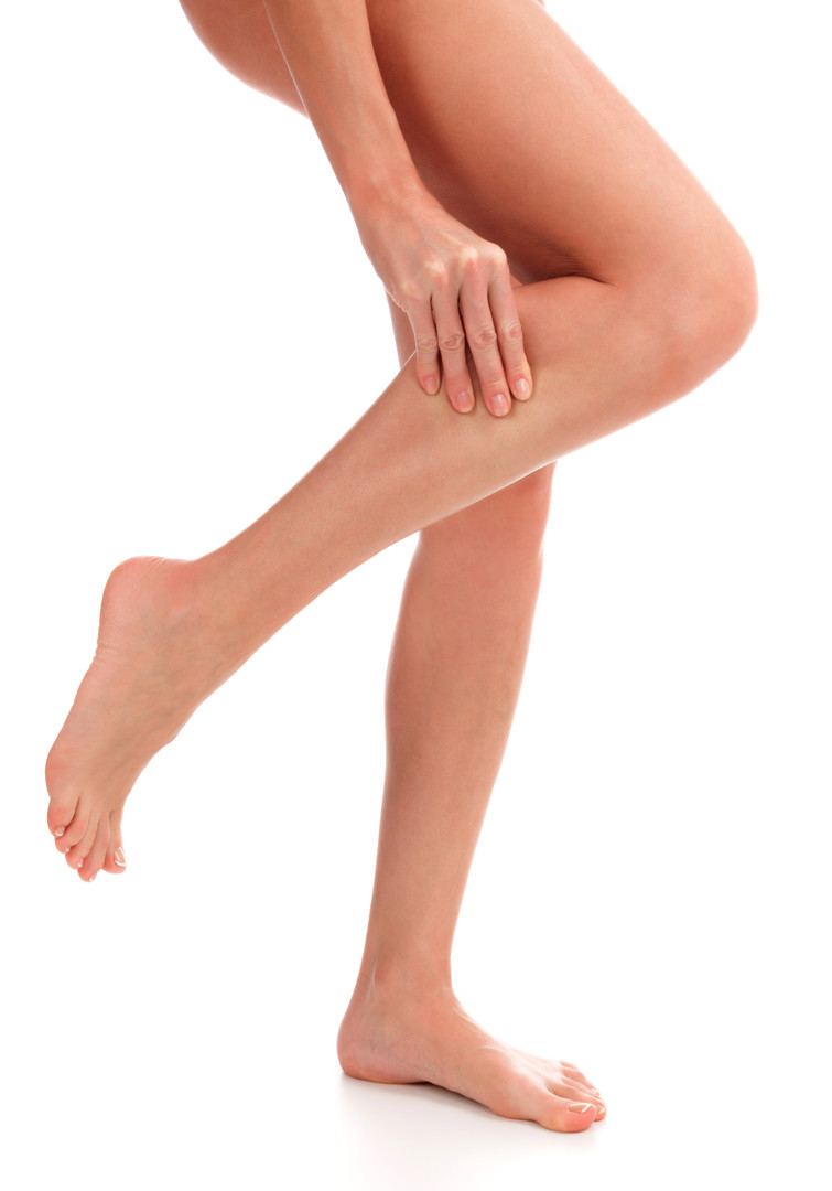 Closeup shot of woman holding sore leg,