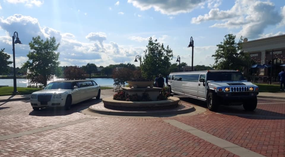 SUV Hummer Limo and Chrysler 300 Limo parked outside Waterfront community for a wedding party.