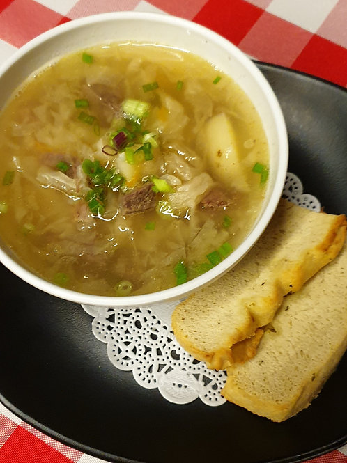 Russian soup Shi with pickled cabbage and beef