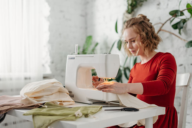 woman-sewing-while-sitting-on-chair-3738