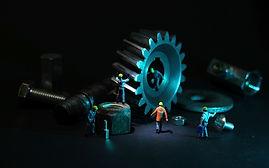 Miniature men on gears.jpg