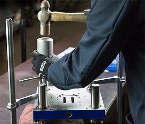Tool and die maker manufacturing metal stampiing die