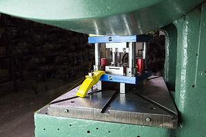Punch press and metal stamping die