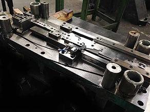 Custom progressive metal stamping tool and die