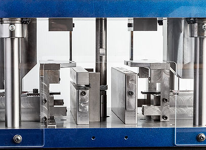 Vinyl extrusion punching three holes through side hole in one hit