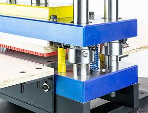Steel rule die and precision 3 platen press